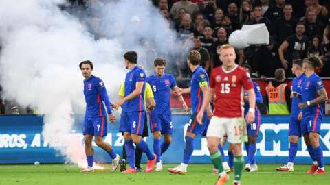 A flare is thrown on to the pitch during England's win over Hungary