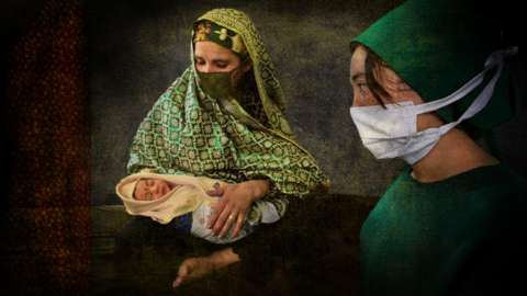 Mother and nurse with newborn baby in Afghanistan
