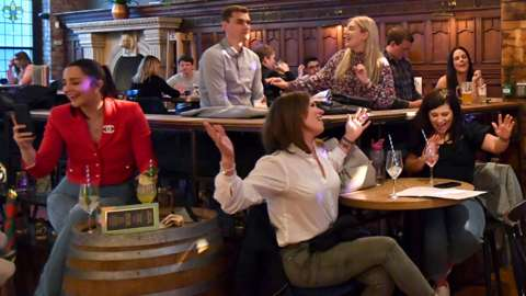People enjoy a live show at a bar in Manchester on 17 May, following the easing of lockdown restrictions