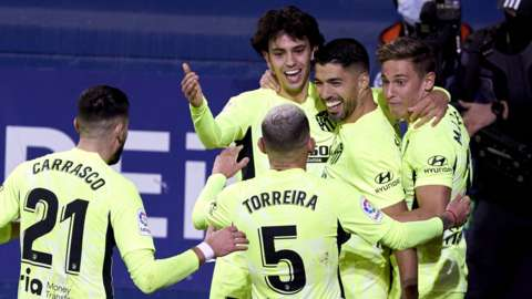 Luis Suarez (second from right) celebrates his winning goal for Atletico against Eibar