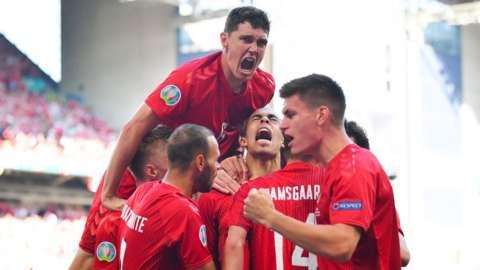 Denmark players celebrate scoring against Belgium