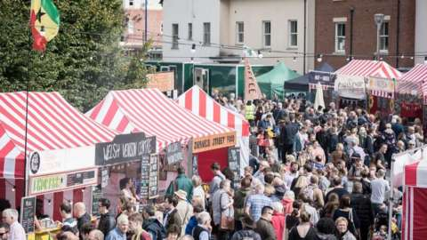 Festival goers fill a road of market stalls at Abergavenny Food Festival 2017