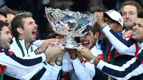 France players raise the Davis Cup in celebration after winning the 2017 title