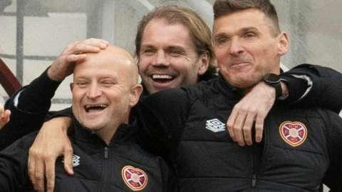 Robbie Neilson celebrates with staff