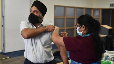 Someone from Stoke's City Mosque receives a vaccination against Covid-19 on 26 February 2021