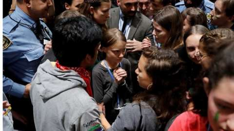 Swedish environmental activist Greta Thunberg (C) and some teenagers from the Fridays for Future movement arrive to attend the fifth day of the UN Climate Change Conference COP25 in Madrid, Spain, 06 December 2019.