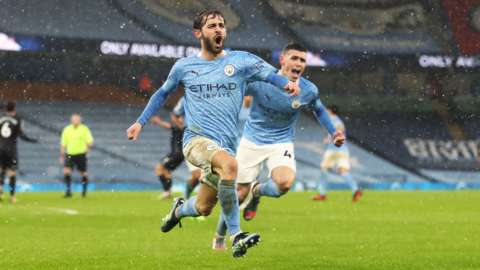 """Bernardo Silva celebrates scoring his side""""s first goal of the game during the Premier League match at the Etihad Stadium, Manchester"""