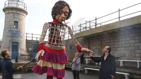 Little Amal is met by Jude Law