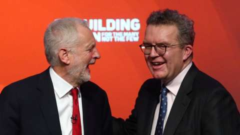 Jeremy Corbyn laughs with Tom Watson, his deputy, at Labour conference