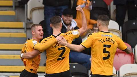 Ollie Cooper of Newport County celebrates scoring the opening goal