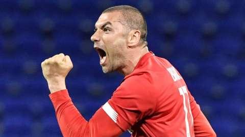 Burak Yilmaz celebrates scoring