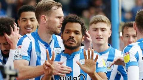 Duane Holmes celebrates scoring for Huddersfield against Hull City