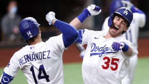 Cody Bellinger and Enrique Hernandez celebrate