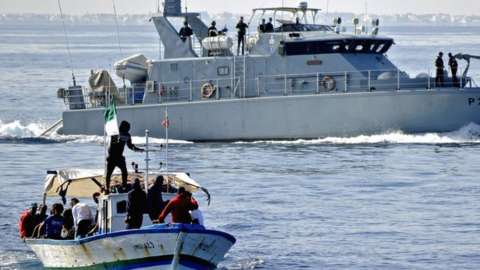 Tunisian Croissant Sportif Chebbien (CSC) football fans, who have threatened for weeks to emigrate to Italy in protest over sanctions against their club, board fishing boats on November 12, 2020 in the Mediterranean port of Chebba, accompanied by the Tunisian coast guard.