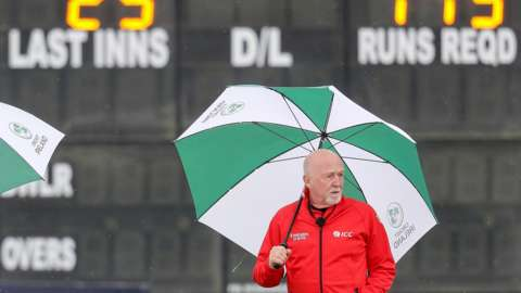 Umpires inspect the malahid pitch before abandoning the first ODI between Ireland and South Africa