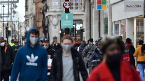 Shoppers in London last year
