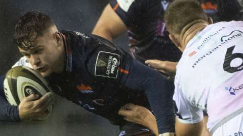 Edinburgh's Darcy Graham is tackled by Ollie Cracknell