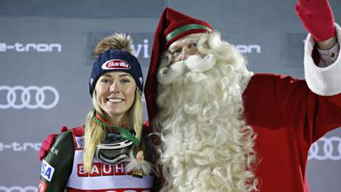 Mikaela Shiffrin on the podium with Father Christmas