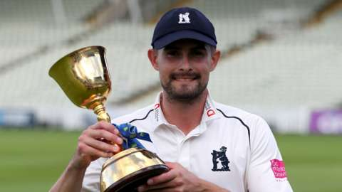 Warwickshire captain Will Rhodes with the County Championship trophy