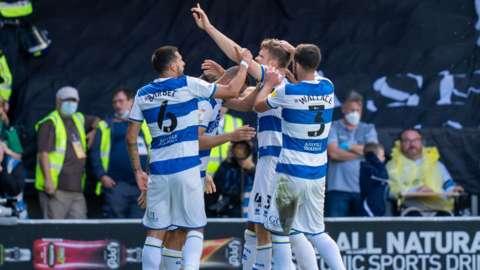 QPR celebrate their goal against Millwall