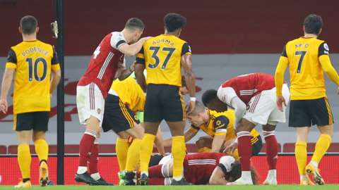 Play is stopped in the Premier League game between Arsenal and Wolves while players David Luiz and Raul Jimenez receive treatment after an accidental clash of heads