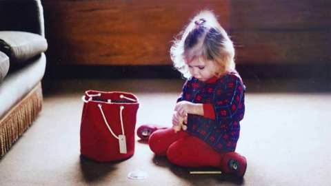 Young child sitting on the floor