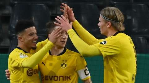 Jadon Sancho celebrates his winner with his Dortmund team-mates