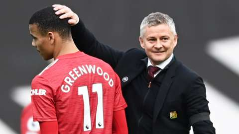 Manchester United manager Ole Gunnar Solskjaer with Mason Greenwood