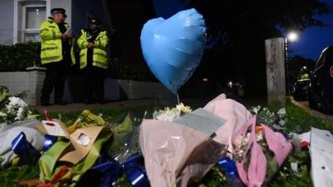 Blue heart balloon outside crime scene