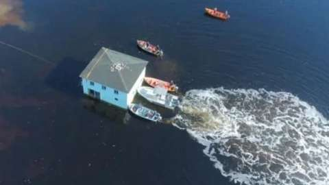 house-moving-across-water.