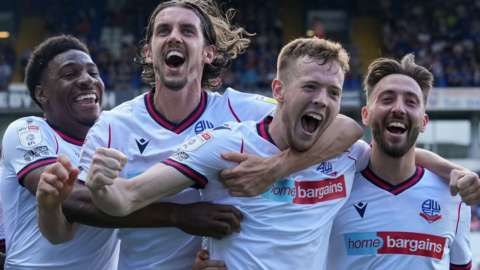 Bolton players celebrate their fifth goal against Ipswich Town