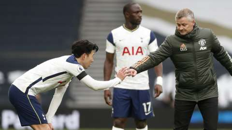 Ole Gunnar Solskjaer bumped fists with Son Heung-min after the game