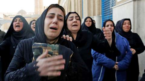Women mourn during the funeral of a man who was killed in a twin suicide bombing