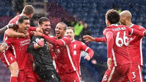 Alisson and team-mates celebrate