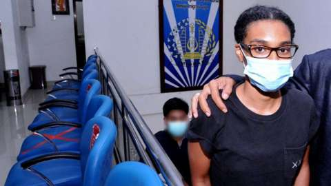 Kristen Gray looks on after being examined at the Indonesian Immigration office in Denpasar, Bali, Indonesia