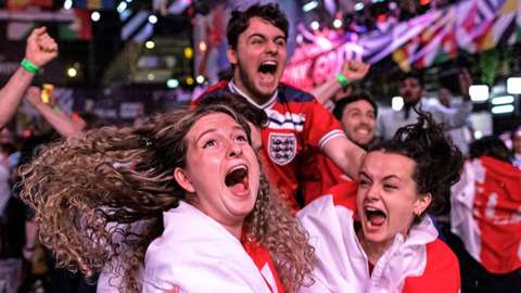 Fans at BOXPARK in Croydon celebrate England reaching the final after watching the Euro 2020 semi final match between England and Denmark.