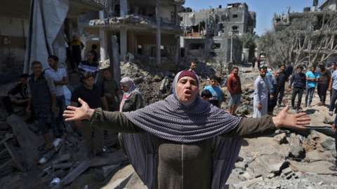 A woman in Gaza reacts to the destruction caused by Israeli bombardments