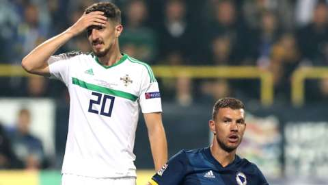 Northern Ireland's Craig Cathcart and Bosnia-Herzegovina's Edin Dzeko during the Nations League game in Sarajevo 13 months ago