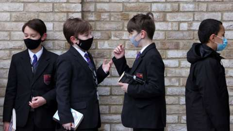 Pupils at Fulham Boys' School queue to get tested
