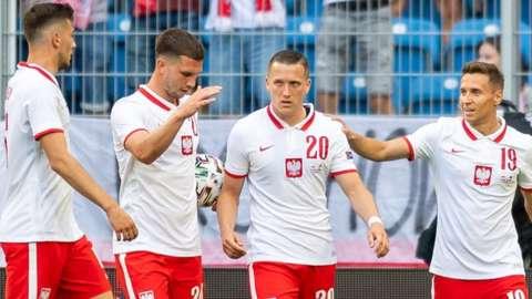 Poland celebrate scoring against Iceland