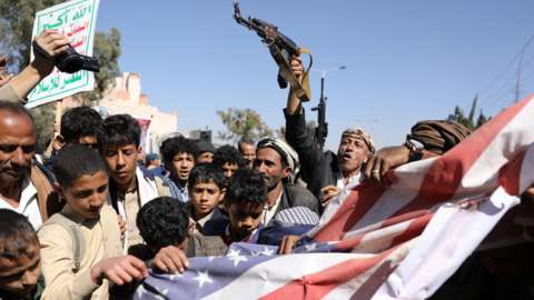 Supporters of Yemen's rebel Houthi movement protest in Sanaa against a decision by the Trump administration to declare it a foreign terrorist organisation (18 January 2021)