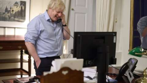 Prime Minister Boris Johnson during a phone call with US Presient Joe Biden
