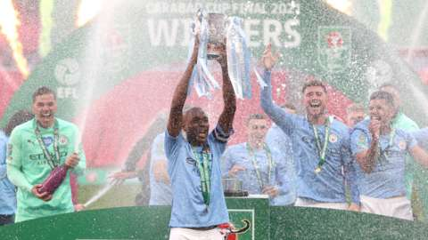 Man City celebrating with the Carabao Cup
