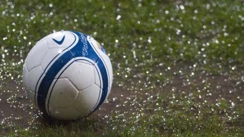 Ball on waterlogged pitch