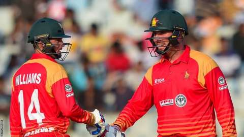 Two Zimbabwe batsman shake hands