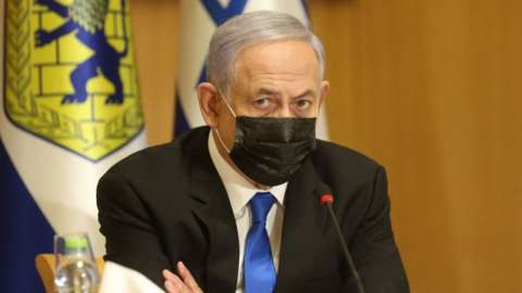 "Israeli Prime Minister Benjamin Netanyahu, wearing a mask for protection against the COVID-19 pandemic, attends a special cabinet meeting on the occasion of ""Jerusalem Day"" at the city's municipality building on May 9, 2021"