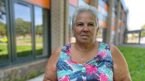 Sheila Mott and the defib she uses to train colleagues at the leisure centre