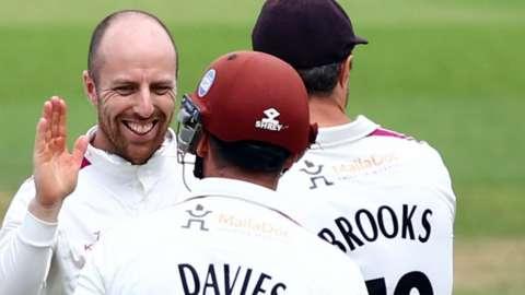 Jack Leach celebrates with Somerset teammates.