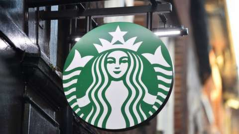A logo outside a branch of Starbucks