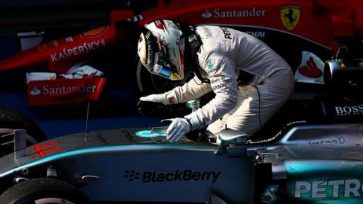 Lewis Hamilton pats his car after winning the Chinese Grand Prix